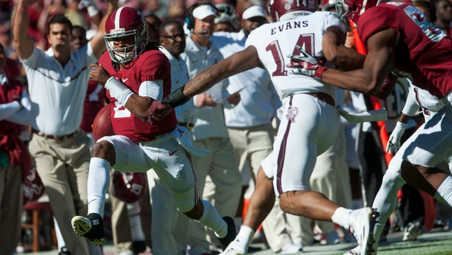 Alabama quarterback Jalen Hurts (2) runs down the sideline against Texas A&M at Bryant-Denny Stadium in Tuscaloosa on Saturday, October 22, 2016.