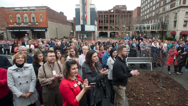 Kindred Healthcare employees and guests applaud a speaker at a ribbon-cutting ceremony for its two new buildings at 656-658 S. Fourth St. on Thursday, Jan. 11, 2018.