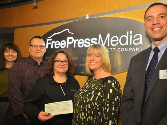 From left, Kasia Abrams, Free Press consumer marketing sales manager,  Brian Schmitt, consumer marketing sales /USAT Network, Carol Dubuque, Free Press  single copy manager, Cassie Lindsay, Donor and corporate relations manager for Vermont Foodbank, and Ben Theriault, director of operations for Hannaford deliver a check to the Foodbank in February 2016.