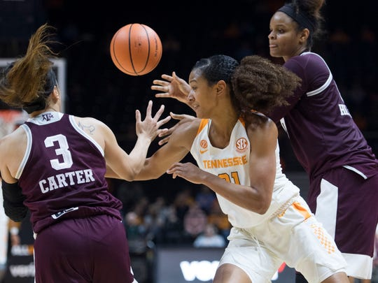 Tennessee's Jaime Nared tries to get the ball between