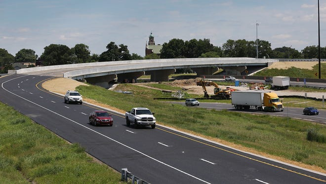 Vehicles use the newly opened I-70/I-65 south split ramp Wednesday, July 22, 2015. The ramp opened a few days ahead of schedule. It was closed nearly two months ago to repair two bridges and pavement, part of $50 million in spending to fix 80 Indiana bridges this year.