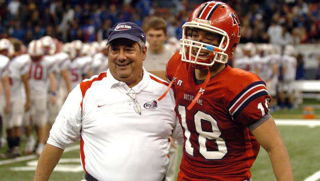 His three sons were a big reason Lewis Cook left college coaching to return to the high school level. Here he celebrates a state championship with his youngeset son Stu in 2009.