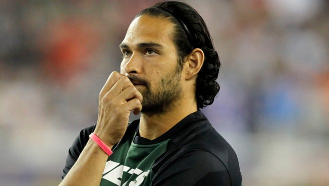 New York Jets quarterback Mark Sanchez (6) on the sidelines during the game agains the New England Patriots at Gillette Stadium.