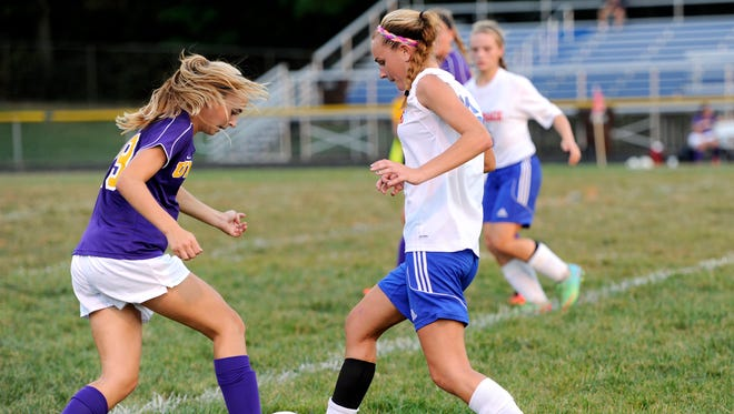 Unioto's Montana Myers tries to steal the ball as Zane Trace's Madisyn Myers tries to kick it during Wednesday's Scioto Valley Conference game.