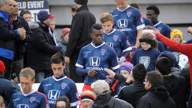 The Indy Eleven make their entrance into the stadium before the game. The Indy Eleven played Indiana University in a pre-season game at Carroll Stadium at IUPUI, April 4, 2014.