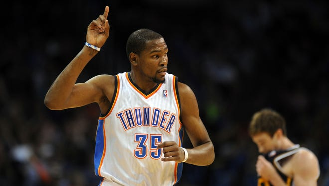 Oklahoma City Thunder forward Kevin Durant (35) reacts after a made shot against the Utah Jazz during the third quarter at Chesapeake Energy Arena.