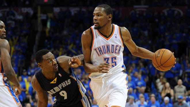 Oklahoma City Thunder forward Kevin Durant drives to the basket against Memphis Grizzlies guard Tony Allen during the fourth quarter at Chesapeake Energy Arena.