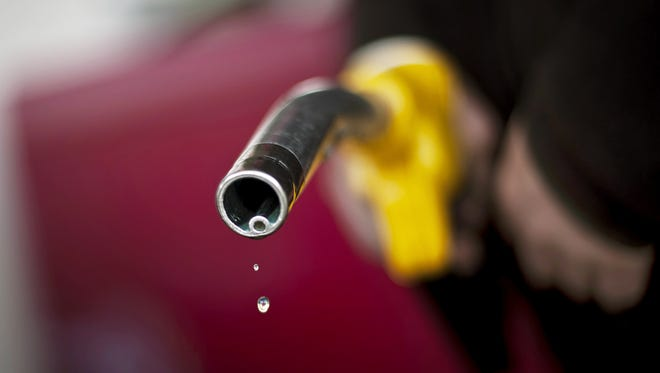 This file picture taken on March 9, 2011 shows a driver after refueling at a Dijon's gas station.