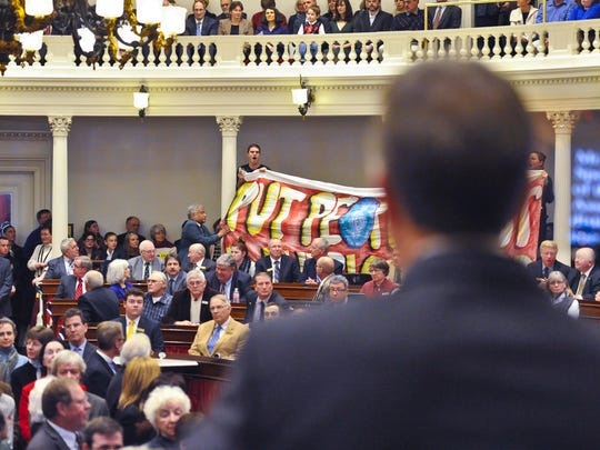 Single-payer protestors disrupt Gov. Peter Shumlin's inauguration ceremony at the Statehouse in Montpelier on Thursday, January 8, 2015.