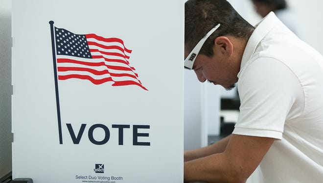 Anthony New Mexico resident Joshua Contreras, 26, votes on Tuesday at the City of Anthony Municipal Complex.