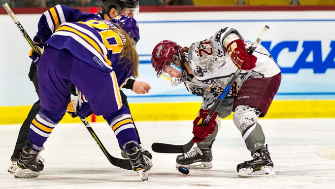 Norwich forward Sarah Schwenzfeier wins a face-off against Elmira on Saturday during the NCAA Division III women's nockey championship at Kreitzberg Arena.