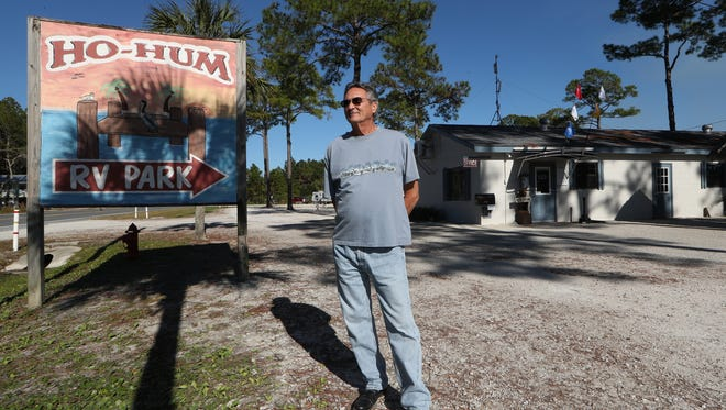 """Mike Hughes, who has owned the Ho-Hum RV Park along the coast in Carrabelle with his wife Toni for 21 years, stands outside the office on Friday, Nov. 10, 2017. """"This is a campground that has been here, and people loved it for over 41 years, the environment here is very friendly,"""" said Hughes."""