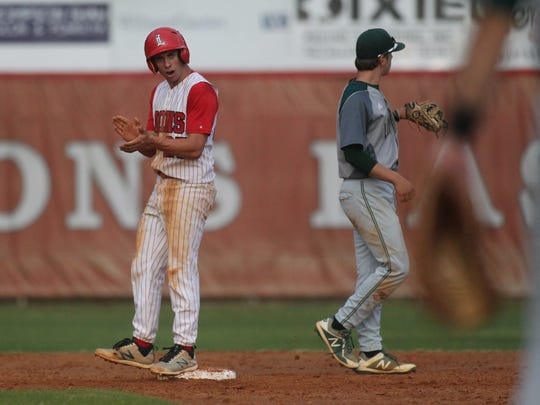 Leon's Tyler Borges pumps up his team after reaching second base.