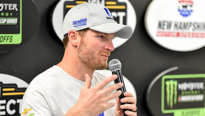 Dale Earnhardt Jr. talks with the media during qualifying for the ISM Connect 300 at the New Hampshire Motor Speedway.
