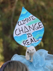 Environmental activists got creative with their signs