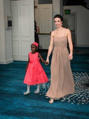 Ashley Lauren (right) escorts Ayana at the Butterfly Ball