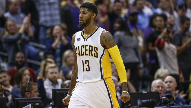 After hitting his third shot in a row late in the fourth quarter, Indiana Pacers forward Paul George (13) heads to the bench after a timeout call by Los Angeles Lakers head coach Luke Walton at Bankers Life Fieldhouse on Nov. 1, 2016.