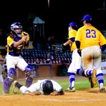 Camels shortstop Collin Teegarden fields, fires and gets the out of the Hazard runner at first base.