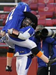 Amherst High School's Garrett Groshek (2) celebrates