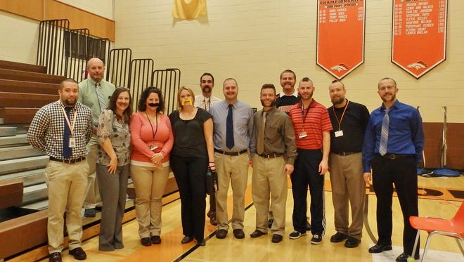 "Cumberland Regional High School's ""Novem-Beard"" participants display their new looks after the fundraiser's head- and face-shaving culminating event. Pictured: (from left) Zach Grigioni, Todd Jorgenson, Cathy Bullock, Dena Brogen, Ashley Trost, Jason Smith, Brandon Krementz, Brett Severino, Gene Thomas, James Ackroyd, Jason Ceresini and Matthew Evans. Participant Ed Carson is not pictured."