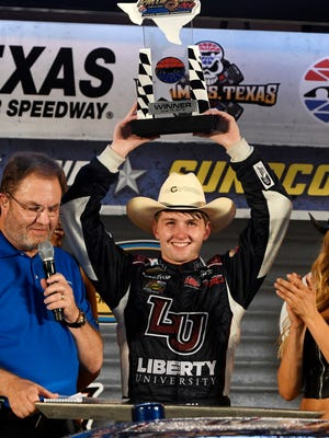 William Byron celebrates in Victory Lane next to track president Eddie Gossage, left, after winning the NASCAR Truck Series auto race at Texas Motor Speedway, on Friday, June 10, 2016, in Fort Worth, Texas.