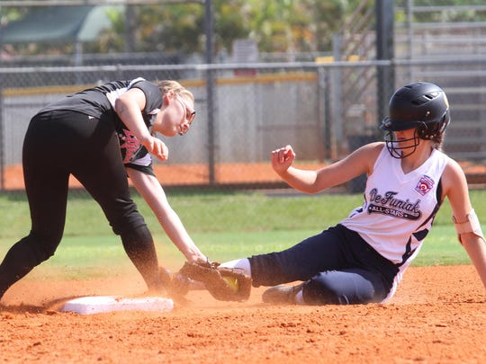 Marion Reed, of District 9, attempts to tag Hannah Poole, of DeFuniak, at 2nd base during a state championship game at Sam Fleishman Sports Complex on Sunday.
