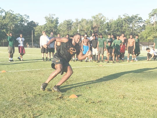 Elijah Watkins shows off his quickness in the six-cone speed drill.