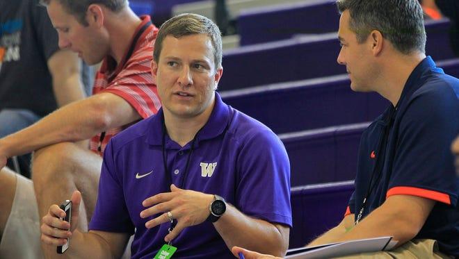 Washington assistant basketball coach T.J. Otzelberger, left, talks with Virginia coach Tony Bennett during the 2013 Nike Global Challenge at Trinity University in Washington, D.C. Otzelberger has returned to Iowa State.