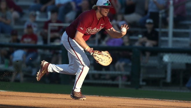 FSU's Rhett Aplin runs to first base for the out after fielding a grounder against UCF during the Seminoles' 6-4 win at Dick Howser Stadium on Tuesday, March 20, 2018.