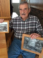 Lifelong resident Jim Bennett holds photos of Hamburg Township in the 1940s.