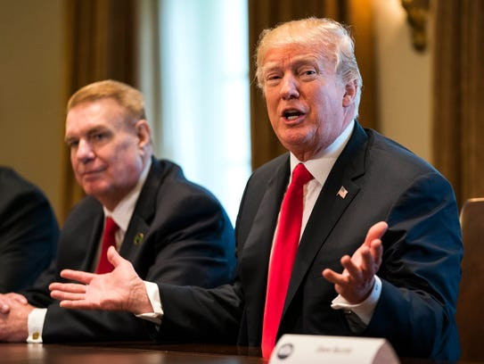 President Trump speaks to the media during a meeting with leaders from the steel and aluminum manufacturing industries in the cabinet Room of the White House Thursday.