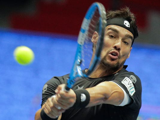 FILE - In this Sunday, Sept. 24, 2017 file photo, Fabio Fognini of Italy returns the ball to Damir Dzumhur of Bosnia and Herzegovina during the St. Petersburg Open ATP tennis tournament final match in St.Petersburg, Russia. There won't be any more tolerance for Fabio Fognini after the Italian vulgarly insulted the chair umpire at the U.S. Open. The Grand Slam board announced Wednesday, Oct. 11 that Fognini will be suspended from participating in two major tournaments _ one of which will be the U.S. Open - if he commits another major offense before the end of 2019. (AP Photo/Dmitri Lovetsky, file)