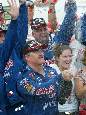 Terry Labonte sprays champagne in Victory Lane after winning the NASCAR Southern 500 on Aug. 31, 2003 at Darlington Raceway.