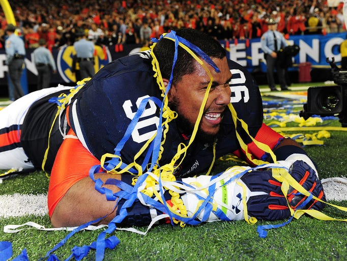 Auburn's Gabe Wright celebrates on the field after the Tigers beat Missouri 59-42.