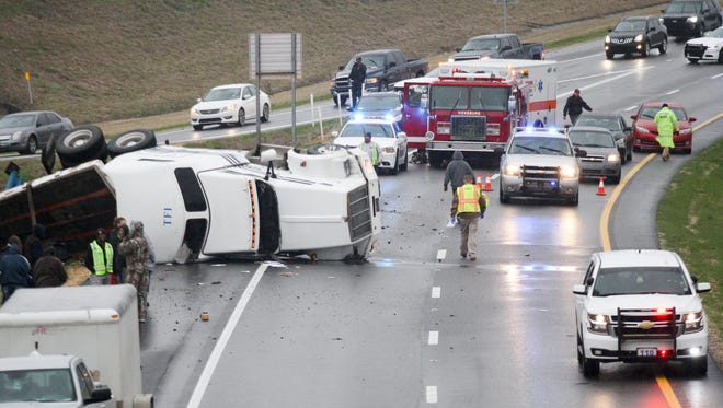 A tractor-trailer turned over on Interstate 20 West blocking both westbound lanes right before the Indiana Avenue Overpass in Vicksburg, Miss., Friday, Jan. 6, 2017. The incident involved one vehicle and the driver was transported away for medical care.