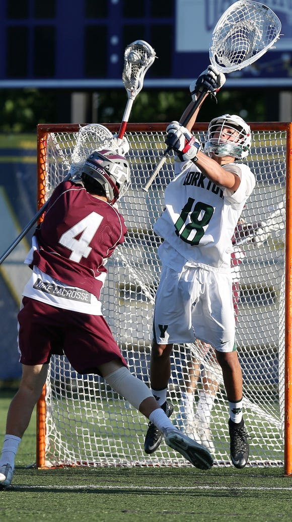 Yorktown goalie Louis Ragusa stops a shot from Garden City's Luke Keating during a state semifinal at SUNY Albany Wednesday.