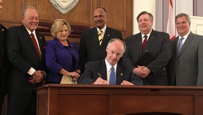 Gov. Robert Bentley signs an order on Tuesday, February 21, 2017 establishing a task force to look at repealing the state sales tax on groceries.