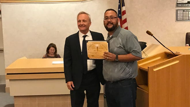 Alex Rodriguez (right), a paraeducator with Palm Desert High School, is recognized for his heroic efforts using CPR by Desert Sands Unified School District Superintendent Scott Bailey.
