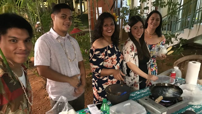 Students made fresh bonelos dagu at the Puengen Minagof Nochebuena event on Dec. 7, 2017.