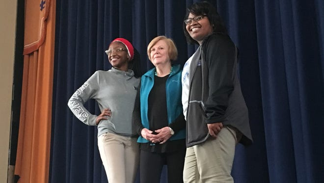 """Kayla Suttles, left, Susan Samuel and Charity Glover, stand on stage in the auditorium at Sidney Lanier High School. The three took part in """"The Nora Project: Women Write,"""" an inter-gernational, interracial playwriting project."""