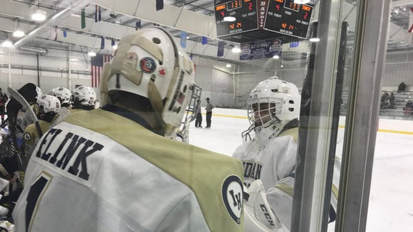 Indian Hills goaltenders Joe Bagi (facing) and Max Flink (1) chat during a time out in the Braves' Jan. 10, 2018 Bergen County hockey tournament game at Ice Vault. While Bagi manned the net for the game, both have made starts contributing to Indian Hills' 9-4-2 record.