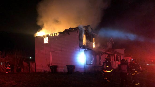 Fire engulfs a home on Danbury Street, in Detroit.