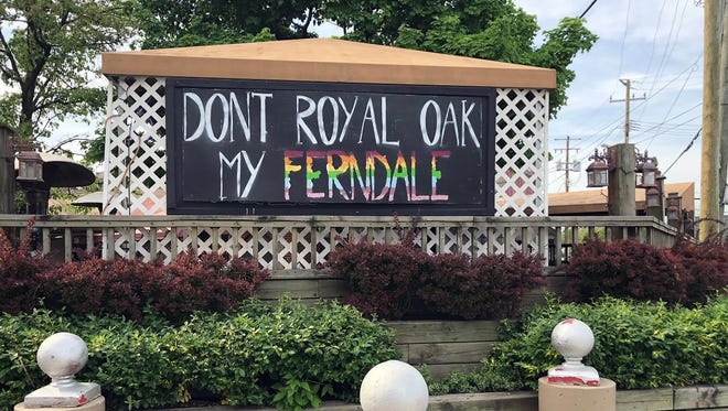 """A sign reading """"Don't Royal Oak My Ferndale"""" is seen Thursday, May 17, 2018 at the former Como's Restaurant location on Woodward and Nine Mile in Ferndale."""