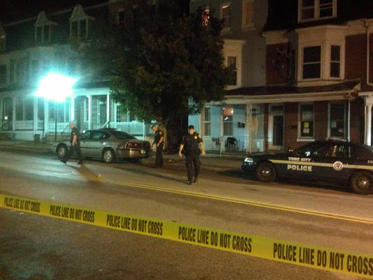 Police investigate the scene of a shooting Wednesday night in the 600 block of West Princess Street. Four victims were taken to the hospital with non-life threatening injuries.