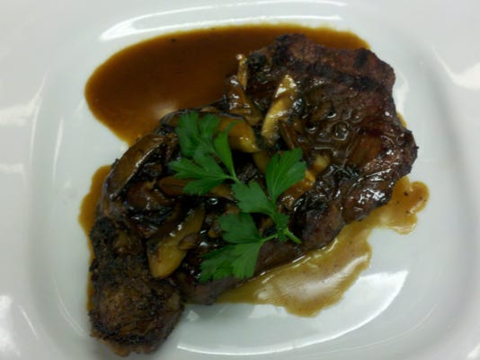 grilled ribey with mixed mushroom demi.JPG