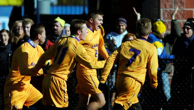 The Rhinebeck High School celebrates a game-tying goal by Laurence Graziano, second from right, against Lansing on Saturday in Middletown.