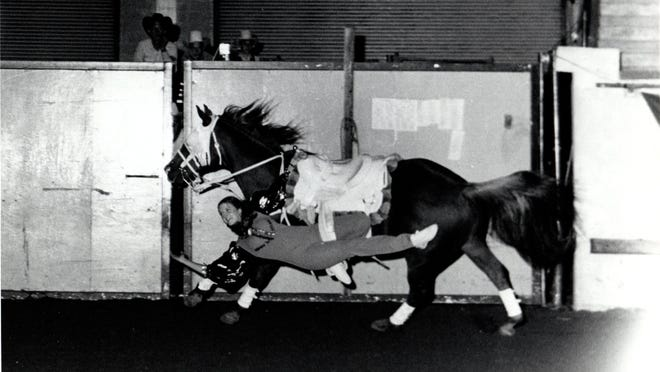 Vickie Shireman trick rides at a rodeo in the 1970s. The Oklahoma woman has secretaried the Phillipsburg rodeo nearly every year since 1971.