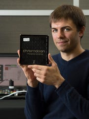 Chromation Design Engineer James Scholtz holds a dice