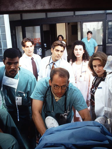 """Twenty years ago, NBC's new fast-paced """"ER"""" hospital drama rushed to the top of the Nielsen drama rankings. Enquirer TV/media writer John Kiesewetter looks back on the staff at Chicago's fictional County Hospital that was introduced to viewers on Sept. 19, 1994 (clockwise from left): Dr. Peter Benton (Eriq LaSalle); medical student John Carter (Noah Wyle); Dr. Doug Ross (George Clooney); nurse Carol Hathaway (Julianna Margulies); Dr. Susan Lewis (Sherry Stringfield); and Dr. Mark Greene (Anthony Edwards)."""