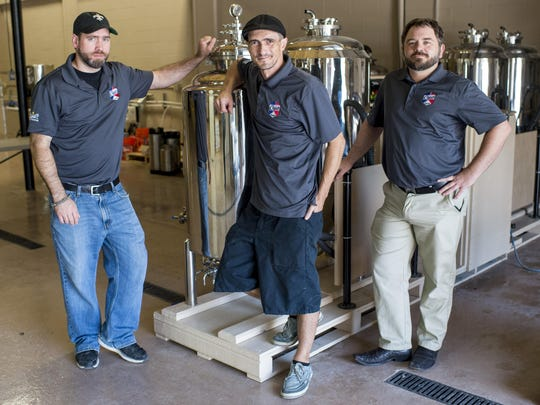 James Lutgring, head brewer and operations manager, Aaron Breaux, assistant brewer, and Chad Lege, general manager, pose for a photograph in the brewing room at Cajun Brewing in Lafayette, La., Tuesday, August 25, 2015.